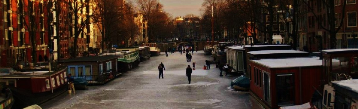 Amsterdam in winter: ice skating on the canals